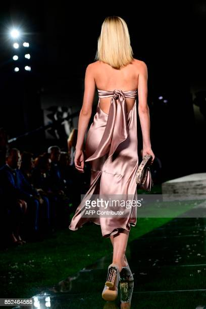 Model presents a creation for fashion house Salvatore Ferragamo during the Women's Spring/Summer 2018 fashion shows in Milan, on September 23, 2017....