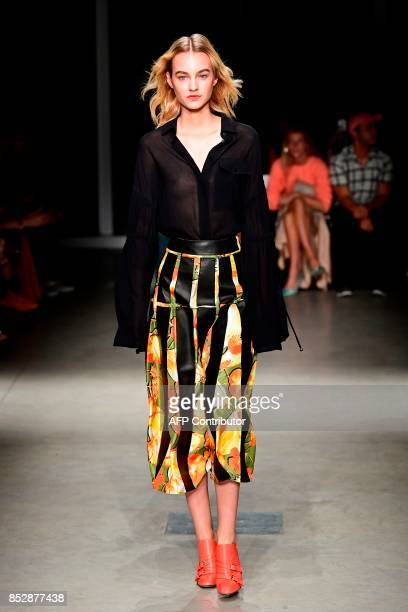 A model presents a creation for fashion house Trussardi during the Women's Spring/Summer 2018 fashion shows in Milan on September 24 2017 / AFP PHOTO...
