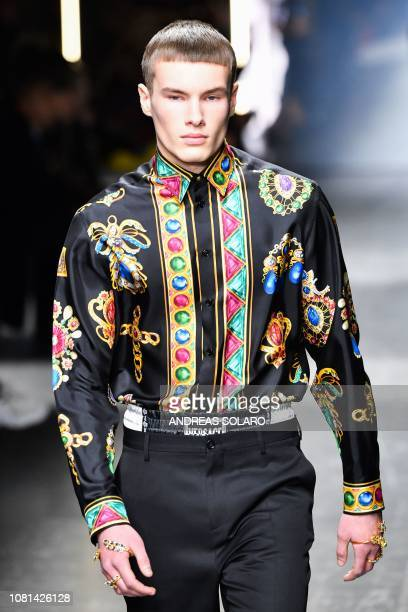 A model presents a creation for fashion house Versace during the Men's Fall/Winter 2019/20 fashion shows in Milan on January 12 2019