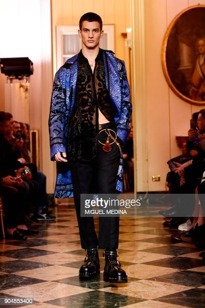 A model presents a creation for fashion house Versace during the Men's Fall/Winter 2019 fashion shows in Milan on January 13 2018 / AFP PHOTO /...