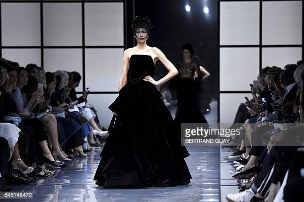 Model presents a creation for Giorgio Armani Prive during the 2016-2017 fall/winter Haute Couture collection fashion show on July 5, 2016 in Paris. /...