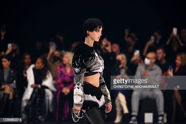 Model presents a creation for Givenchy during the Women's Spring-Summer 2022 Ready-to-Wear collection fashion show in Paris La Defense, Nanterre, as...
