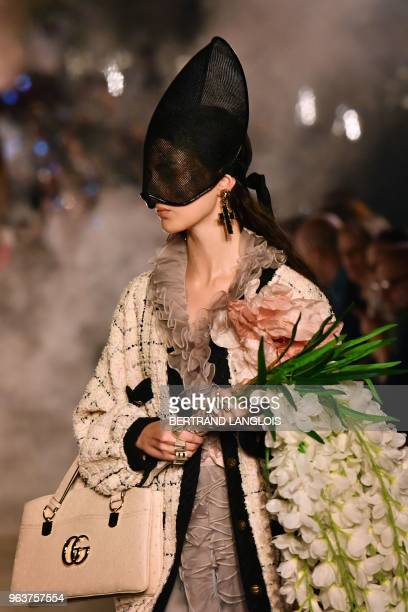 A model presents a creation for Gucci during the 2019 Gucci Croisiere fashion show on May 30 2018 at Alyscamps in Arles