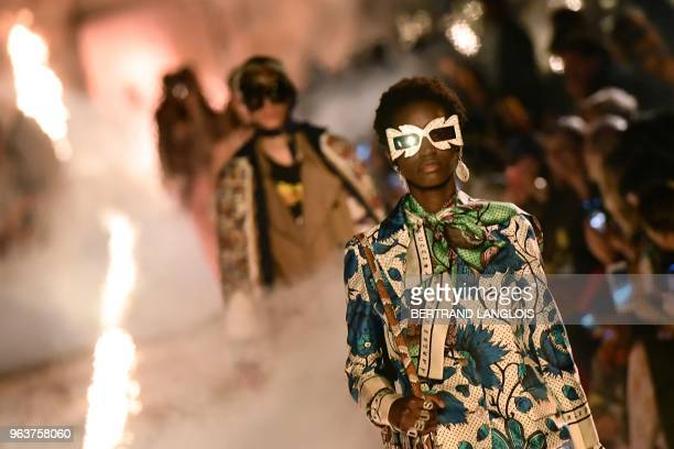 TOPSHOT A model presents a creation for Gucci during the 2019 Gucci Croisiere fashion show on May 30 2018 at Alyscamps in Arles