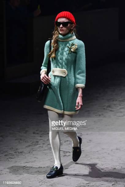 A model presents a creation for Gucci's men's fall/winter 2020/21 fashion collection in Milan on January 14 2020