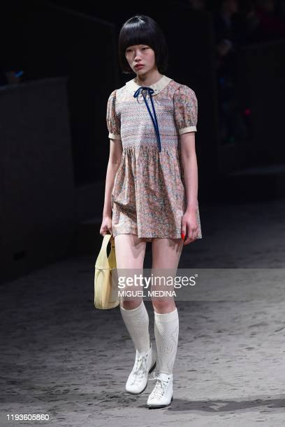 Model presents a creation for Gucci's men's fall/winter 2020/21 fashion collection in Milan on January 14, 2020.
