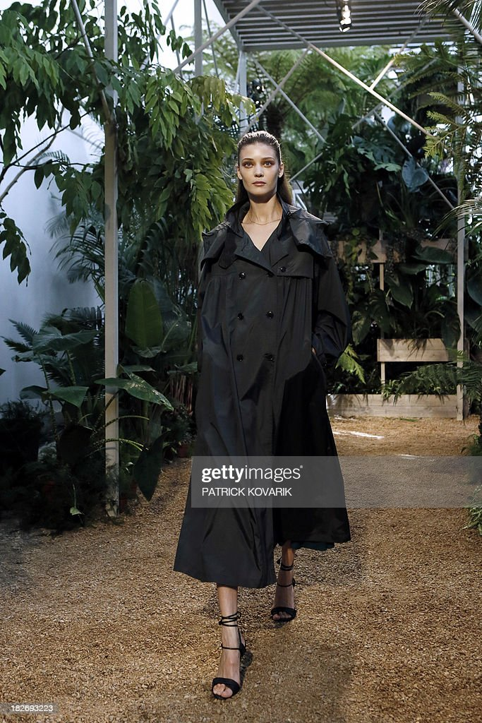A model presents a creation for Hermes during the 2014 Spring/Summer ready-to-wear collection fashion show, on October 2, 2013 in Paris.