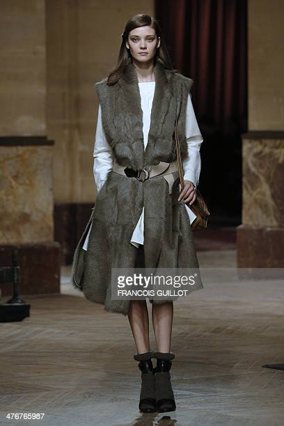 A model presents a creation for Hermes during the 2014/2015 Autumn/Winter readytowear collection fashion show on March 5 2014 in Paris AFP PHOTO /...