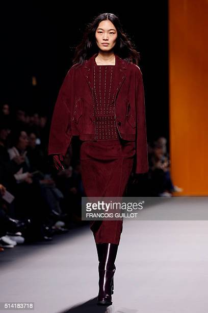 A model presents a creation for Hermes during the 20162017 fall/winter readytowear collection on March 7 2016 in Paris AFP PHOTO / FRANCOIS GUILLOT /...