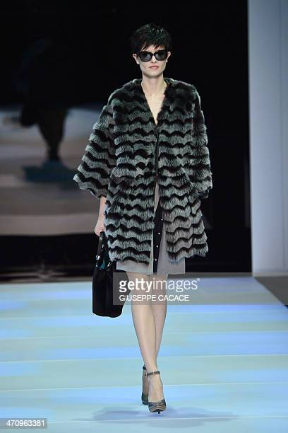 A model presents a creation for Italian fashion label Emporio Armani as part of the Autumn/Winter 2014 Milan Collections during Women's fashion week...