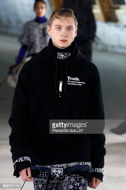 A model presents a creation for Japanese brand Sacai by designer Chitose Abe bearing the lines 'Truth It's more important now than ever' during the...