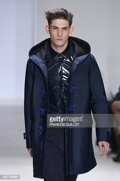 Model presents a creation for John Lawrence Sullivan during the Fall/Winter 2014/2015 men's fashion show in Paris on January 2014. AFP PHOTO /...