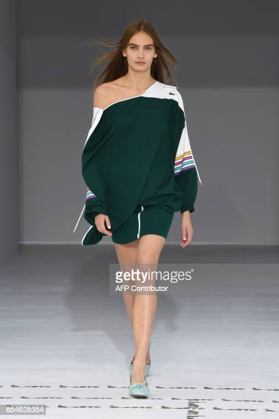 A model presents a creation for Lacoste during the women's 2018 Spring/Summer readytowear collection fashion show in Paris on September 27 2017 / AFP...