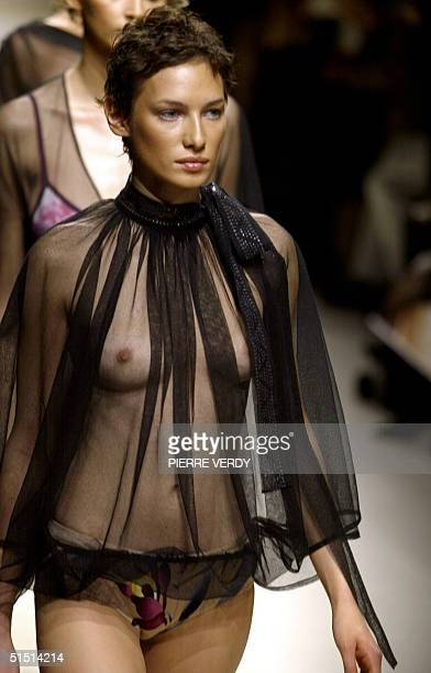A model presents a creation for Leonard 11 October 2001 during the spring/summer 2002 readytowear collections in Paris