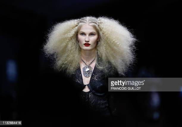 """Model presents a creation for L'Oreal during the """"La French - Art Of Hair Coloring"""" show on March 24, 2019 in Paris."""