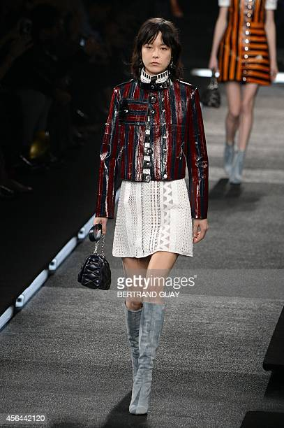 Model presents a creation for Louis Vuitton during the 2015 Spring/Summer ready-to-wear collection fashion show, on October 1, 2014 in Paris. AFP...