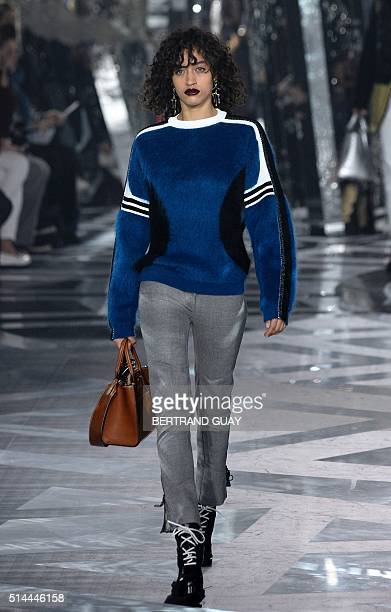 A model presents a creation for Louis Vuitton during the 20162017 fall/winter readytowear collection fashion show on March 9 2016 in Paris AFP PHOTO...