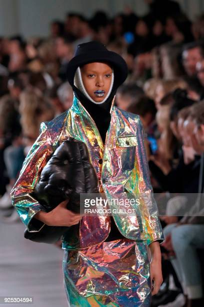 A model presents a creation for Maison Margiela during the 2018/2019 fall/winter collection fashion show on February 28 2018 in Paris / AFP PHOTO /...