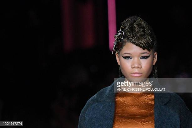 Model presents a creation for Miu Miu during the Women's Fall-Winter 2020-2021 Ready-to-Wear collection fashion show in Paris, on March 3, 2020.