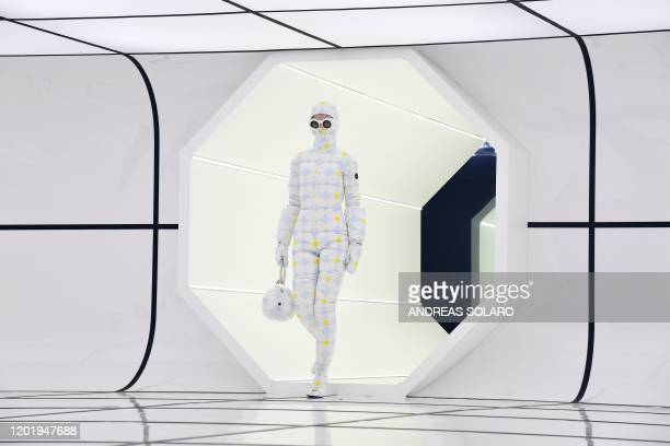 A model presents a creation for Moncler's Women's Fall/Winter 20202021 fashion collection on February 19 2020 in Milan