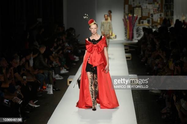 A model presents a creation for Moschino fashion house during the Women's Spring/Summer 2019 fashion shows in Milan on September 20 2018