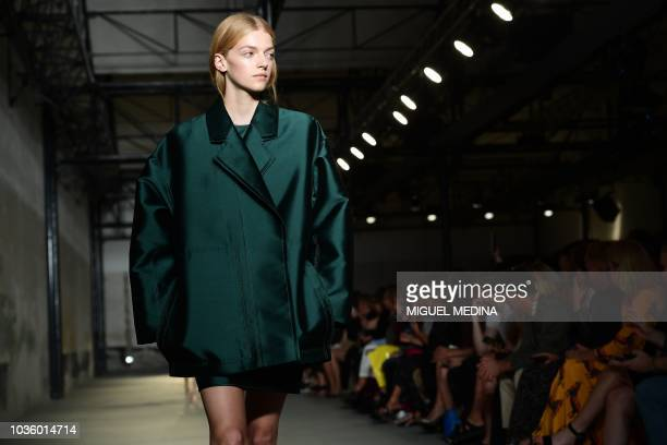 A model presents a creation for N21 fashion house during the Women's Spring/Summer 2019 fashion shows in Milan on September 19 2018