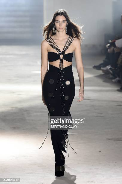 A model presents a creation for Proenza Schouler during the 2018 spring/summer Haute Couture collection fashion show on January 22 2018 in Paris /...