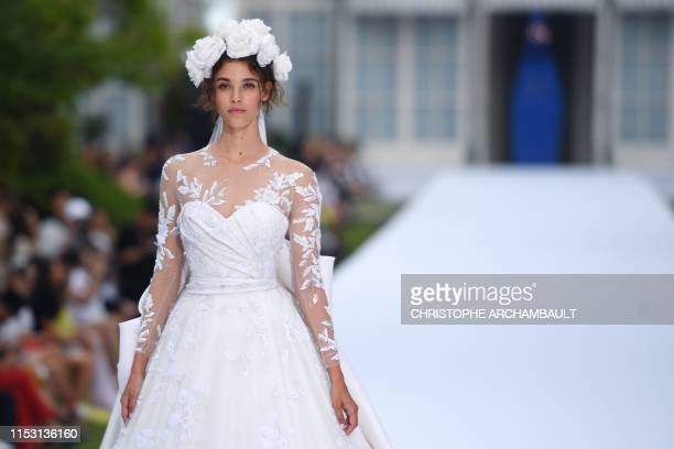 A model presents a creation for Ralph Russo at the Hotel de Charost during the Women's FallWinter 2019/2020 Haute Couture collection fashion show in...