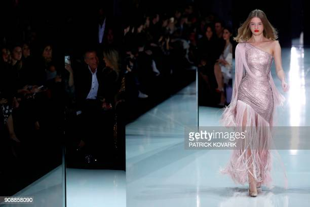 A model presents a creation for Ralph Russo during the 2018 spring/summer Haute Couture collection fashion show on January 22 2018 in Paris / AFP...