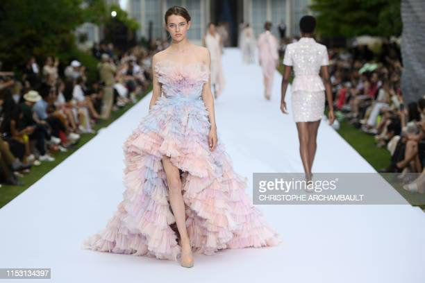 A model presents a creation for Ralph Russo during the Women's FallWinter 2019/2020 Haute Couture collection fashion show in Paris on July 1 2019
