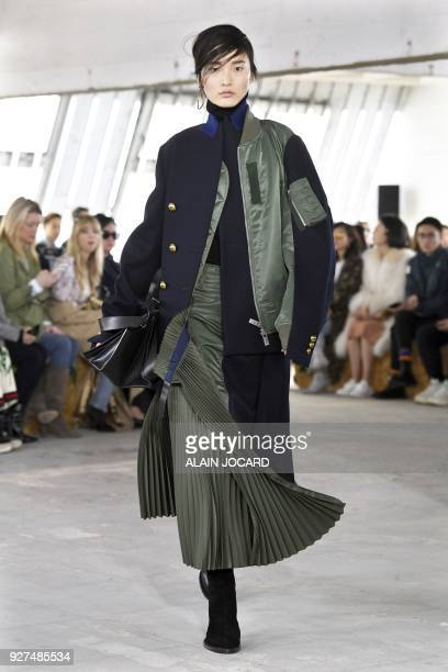 Model presents a creation for Sacai during the 2018/2019 fall/winter collection fashion show on March 5, 2018 in Paris. / AFP PHOTO / ALAIN JOCARD