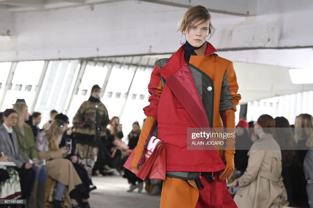 A model presents a creation for Sacai during the 2018/2019 fall/winter collection fashion show on March 5, 2018 in Paris. /