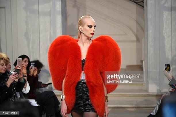 A model presents a creation for Saint Laurent during the 20162017 fall/winter readytowear collection on March 7 2016 in Paris AFP PHOTO / MARTIN...