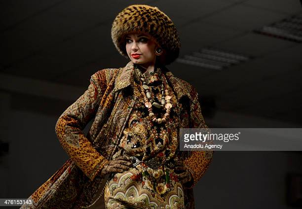 A model presents a creation for Slava Zaitsev's readytowear fall/winter 20142015 fashion collection in Moscow Russia on March 2 2014