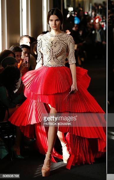 A model presents a creation for Stephane Rolland during the 2016 spring/summer Haute Couture collection on January 26 2016 in Paris AFP PHOTO /...