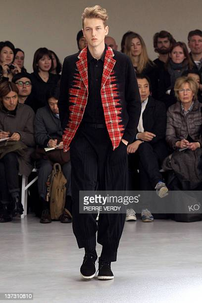 Model presents a creation for the label Issey Miyake during the Autumn-Winter 2012/2013 men's fashion collection show, on January 19, 2012 in Paris....