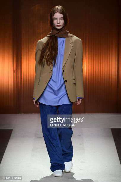 Model presents a creation for Tod's Women Fall - Winter 2020 fashion collection on February 21, 2020 in Milan.