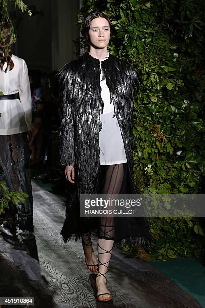 A model presents a creation for Valentino during the 2014/2015 Haute Couture FallWinter collection fashion show on July 9 2014 in Paris AFP PHOTO /...
