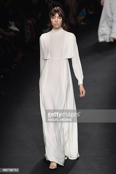 A model presents a creation for Valentino during the 20152016 fall/winter readytowear collection fashion show on March 10 2015 in Paris AFP PHOTO /...