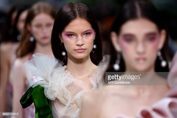 A model presents a creation for Valentino during the women's 2018 Spring/Summer readytowear collection fashion show in Paris on October 1 2017 / AFP...