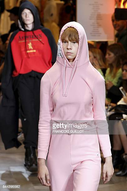 Model presents a creation for Vetements during the 2016-2017 fall/winter collection fashion show on July 3, 2016 in Paris. / AFP / FRANCOIS GUILLOT