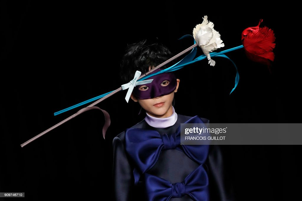 TOPSHOT - A model presents a creation for Viktor & Rolf during the 2018 spring/summer Haute Couture collection fashion show on January 24, 2018 in Paris. /