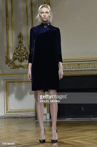 A model presents a creation for YDE during the 2014/2015 Autumn/Winter readytowear collection fashion show on March 5 2014 in Paris AFP PHOTO /...