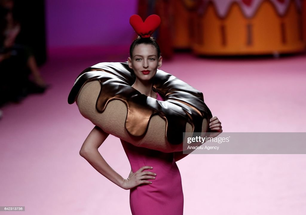 A model presents a creation from Agatha Ruiz de la Prada's Autumn/Winter 2017-2018 collection during the Mercedes-Benz Madrid Fashion Week in Madrid on February 17, 2017.