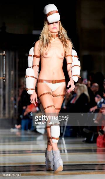 A model presents a creation from British designer Pam Hogg during a catwalk show for the Spring/Summer 2019 collection on the first day of London...