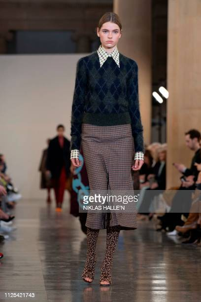 A model presents a creation from British designer Victoria Beckham during their 2019 Autumn / Winter collection catwalk show at London Fashion Week...