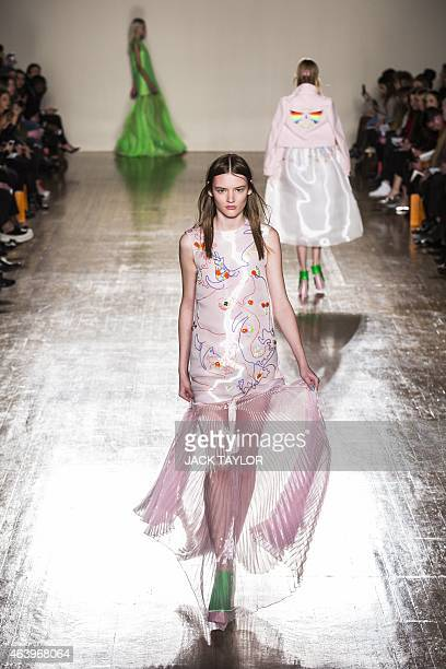 A model presents a creation from British fashion label Fyodor Golan at the Royal College of Surgeons during the 2015 Autumn / Winter London Fashion...