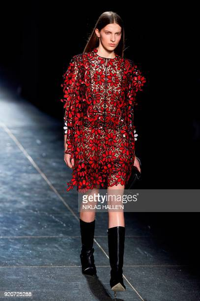 A model presents a creation from designer Christopher Kane during their catwalk show on the fourth day of London Fashion Week Autumn/Winter 2018 in...