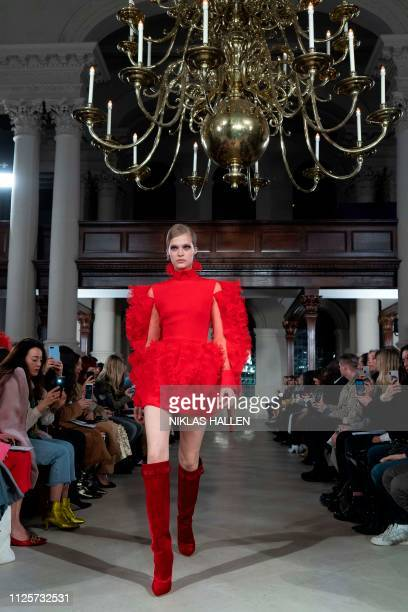 A model presents a creation from designer David Koma during his 2019 Autumn / Winter collection catwalk show at London Fashion Week in London on...