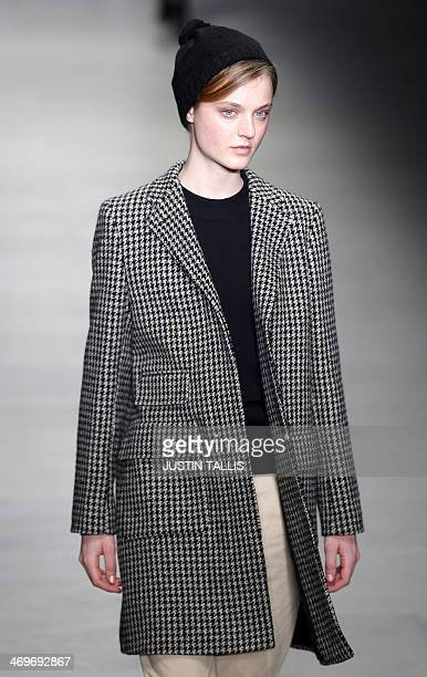 A model presents a creation from designer Margaret Howell during the 2014 Autumn / Winter London Fashion Week in London on February 16 2014 AFP PHOTO...